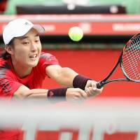 Go Soeda plays a shot during his first-round loss to France's Adrian Mannarino at the Japan Open on Monday. | KYODO