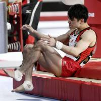 Six-time world all-around gymnastics champion Kohei Uchimura's reign ended on Monday after suffering an injury at this year's competition in Montreal. | KYODO