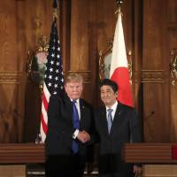 U.S. President Donald Trump and Prime Minister Shinzo Abe hold a joint news conference at the Akasaka Palace on Monday in Tokyo. | AP
