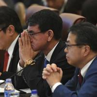 Foreign Minister Taro Kono (center) attends the opening of the APEC ministerial meeting ahead of the Asia-Pacific Economic Cooperation (APEC) summit leaders meetings in the central Vietnamese city of Danang on Wednesday. | AP