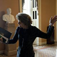 Sen.Lisa Murkowski, a Republican from Alaska, gestures while walking to a closed-door GOP conference meeting to discus tax reform at the U.S. Capitol in Washington on Thursday.   BLOOMBERG
