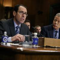 Justice Department sues to block AT&T's $85 billion merger with Time Warner