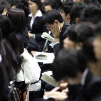 Pay for new graduates in Japan is said to be far below their counterparts in the United States. | BLOOMBERG