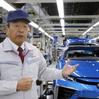 Toyota Motor Corp. Chairman Takeshi Uchiyamada speaks at the automaker's Motomachi plant in Toyota, Aichi Prefecture, on Oct. 30, where the Mirai fuel cell vehicle is being assembled. | AP