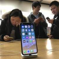 With Apple Inc. selling its first phone boasting an organic light-emitting diode display — a sharp, vibrant screen that uses less energy — Japan Steel Works is counting on that being good for its own bottom line. | AP