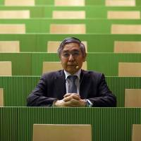 Bank of Japan Gov. Haruhiko Kuroda sits for a photographer before delivering a speech at the University of Zurich in Zurich, Switzerland, on Monday. | BLOOMBERG