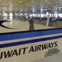 Kuwait Airways check-in counters at Kuwait Airport are seen in 2012. A German court has ruled that Kuwait's national airline didn't have to transport an Israeli citizen because the carrier would face legal repercussions at home if it did. The Frankfurt state court noted in its verdict Thursday that Kuwait Airways is not allowed to close contracts with Israelis under Kuwaiti law because of the Middle Eastern country's boycott of Israel. | AP