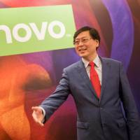 Yang Yuanqing, chairman and CEO of Lenovo Group Ltd., gives a news conference in Hong Kong in May. Lenovo will take over Fujitsu Ltd.'s PC business by taking a majority stake in a joint venture with Fujitsu as well as the state-owned Development Bank of Japan.   BLOOMBERG