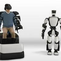 Toyota Motor Corp.'s T-HR3 is controlled from a Master Maneuvering System that allows the entire body of the robot to be operated through wearable controls. | TOYOTA MOTOR CORP.