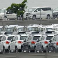 Mitsubishi Motors Corp. vehicles in Nagoya await shipment. | BLOOMBERG