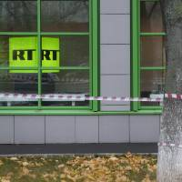 Russian state-owned television station RT's logo is seen at the window of the company's office in Moscow Oct. 27. Russian state-funded TV channel RT has registered with the Justice Department as a foreign agent after pressure from the U.S. government, documents released Monday show. | AP