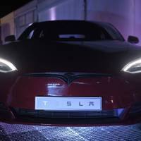 A Tesla Model S electric vehicle is displayed during a Tesla Inc. event at the Hornsdale wind farm, operated by Neoen SAS, near Jamestown, South Australia, on Sept. 29. | BLOOMBERG