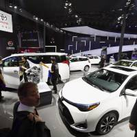 Visitors view cars at Toyota Motor Corp.'s booth on Friday, as the Guangzhou International Automobile Exhibition opens at the China Import and Export Fair Complex in Guangzhou. | KYODO
