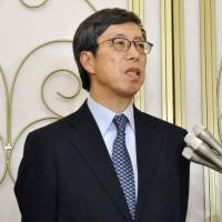Kazuyoshi Umemoto, Japan's chief negotiator for the Trans-Pacific Partnership free trade pact, speaks to the media Wednesday after the remaining parties wrapped up the latest round of talks in Urayasu, Chiba Prefecture. | KYODO