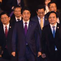 Prime Minister Shinzo Abe arrives at the international airport in Danang, Vietnam, ahead of the Asia-Pacific Economic Cooperation (APEC) Summit on Thursday. | AFP-JIJI