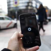 Uber's tie-up with SoftBank still faces a long road ahead, although the proposed deal suggests the ride-hailing giant is set to come of age in the business world. | BLOOMBERG