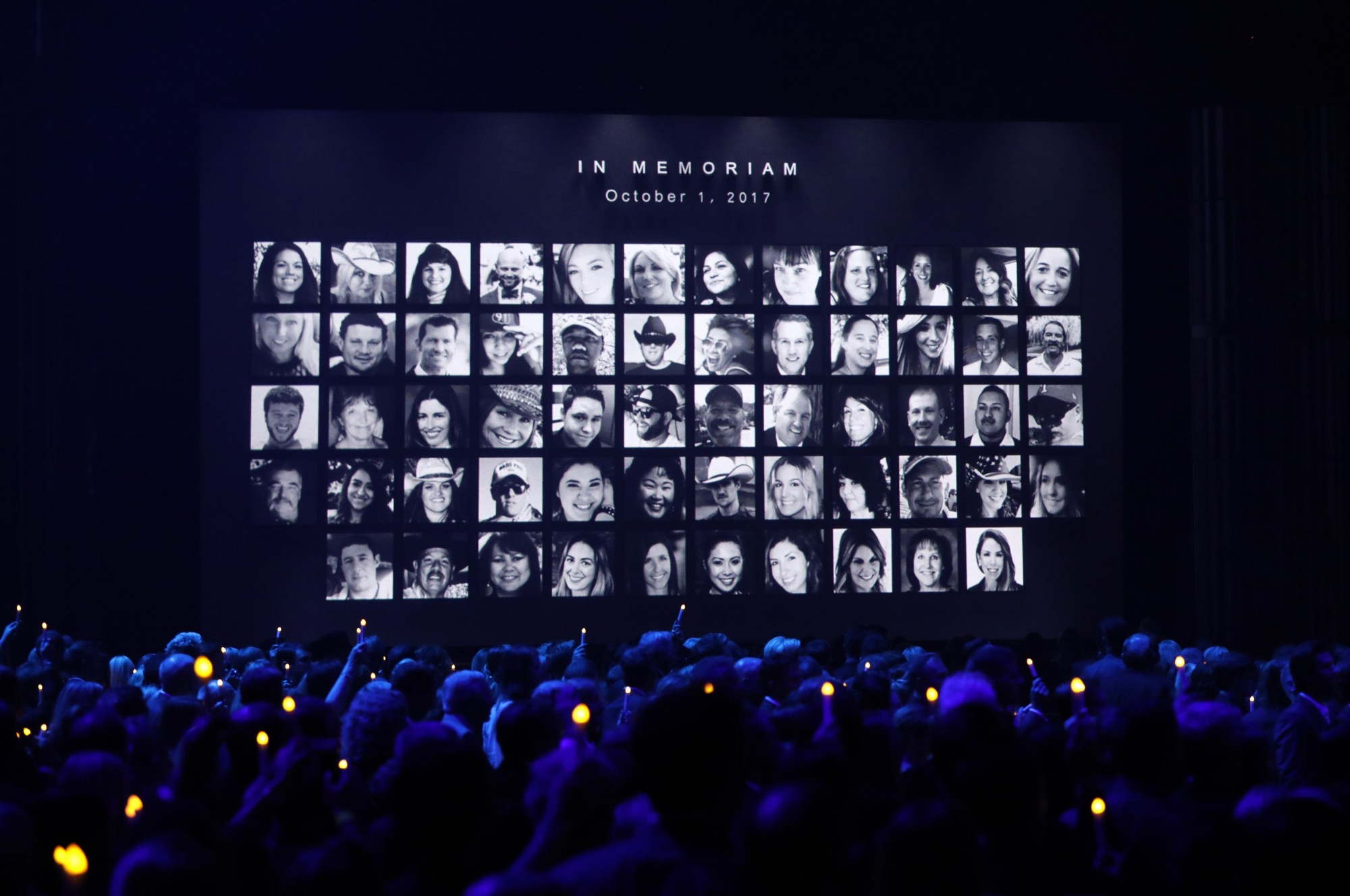 Images of those killed in the Oct. 1 mass shooting in Las Vegas are shown during the in memoriam segment of the 51st Country Music Association Awards show. | REUTERS