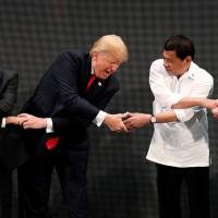 Trump puts strategic interests before rights and embraces Duterte as Asia trip winds down