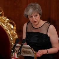 British Prime Minister Theresa May makes a speech at the Lord Mayor's Banquet at the Guildhall in London's financial district on Monday. Beside her is the lord mayor of the City of London, Charles Bowman. | REUTERS