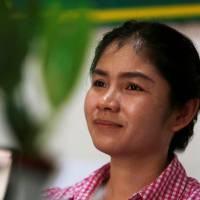 Sin Rozeth, of the opposition Cambodia National Rescue Party, smiles during an interview at her office in Cambodia's Battambang province last month. | REUTERS