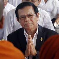 The leader of the opposition Cambodia National Rescue Party, Kem Sokha, prays on March 30 in Phnom Penh during a Buddhist ceremony to mark the 20th anniversary of an attack on anti-government protesters in 1997. | AP