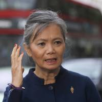 Mu Sochua, the deputy leader of the Cambodia National Rescue Party, speaks during an interview in London on Thursday. She has called for international sanctions to push Cambodia to hold democratic elections. | AP
