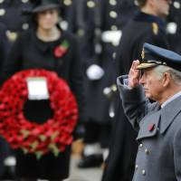 Prince Charles leads Remembrance day ceremony for British war dead on behalf of aging queen