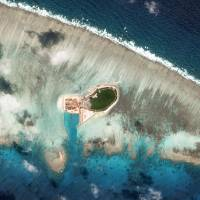 A satellite photo shows Chinese-controlled Tree Island, part of the Paracel Islands group in the South China Sea, on Oct. 12. | PLANET LABS / HANDOUT / VIA REUTERS