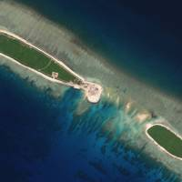 A satellite photo shows Chinese-controlled North Island, part of the Paracel Islands group in the South China Sea, on Sept.29. | PLANET LABS / HANDOUT / VIA REUTERS