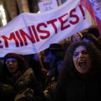 Demonstrators call for a legal minimum age for sexual consent, in Paris on Tuesday. The banner reads, 'Still feminists.' | AP