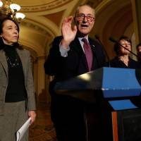 Senate Minority Leader Chuck Schumer, accompanied by Sen. Maria Cantwell (D-WA), speaks with reporters following the party luncheons on Capitol Hill in Washington Tuesday. | REUTERS