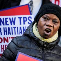 Haitians in U.S. upset that their 'champion' Trump has ended their protected status