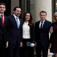 French President Emmanuel Macron and his wife, Brigitte Macron (right), stand with Lebanese Prime Minister Saad Hariri and his wife, Lara Hariri, and their elder son, Hussam, at the Elysee Palace in Paris on Saturday. | REUTERS