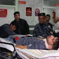 An earthquake victim is aided at Sulaimaniyah Hospital Sunday in Sulaimaniyah, Iraq. Officials in Iran reports at least 30 dead and Iraqi officials report six. The U.S. Geological Survey said the magnitude 7.3 temblor was centered 30 km (19 miles) southwest of Halabja, Iraq, near the border with Iran. | AFP-JIJI