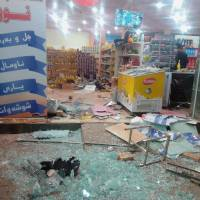 A damaged storefront is seen after an earthquake in Halabja, Iraq, Sunday. | OSAMA GOLPY / RUDAW / SOCIAL MEDIA / VIA REUTERS