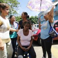 Venezuelans wait to get treatment for malaria at a health center in San Felix on Nov. 3. | REUTERS