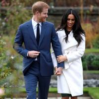 Britain's Prince Harry walks with Meghan Markle in the Sunken Garden of Kensington Palace, London, after their engagement was announced, on Nov. 27. | REUTERS