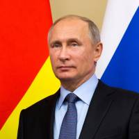 Russian President Vladimir Putin looks on during a signing ceremony after a meeting with President of Georgia's breakaway South Ossetia region Anatoly Bibilov at the Novo-Ogaryovo state residence outside Moscow Tuesday. | REUTERS
