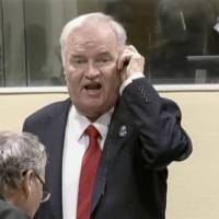 Ex-Bosnian Serb wartime general Ratko Mladic reacts in court at the International Criminal Tribunal for the former Yugoslavia (ICTY) in the Hague, Netherlands, in this still image taken from a video released by the International Criminal Tribunal for the former Yugoslavia (ICTY) Wednesday.   INTERNATIONAL CRIMINAL TRIBUNAL FOR THE FORMER YUGOSLAVIA (ICTY) / HANDOUT / VIA REUTERS