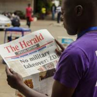 Mugabe apparently out after 37-year reign but no one calling military takeover a coup