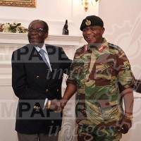 Smiles and handshakes as Robert Mugabe meets with military chief amid uncertainty