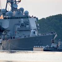 The guided-missile destroyer USS Fitzgerald returns to port in Yokosuka, Kanagawa Prefecture, following a June collision with a merchant vessel while operating southwest of Tokyo Bay. | U.S. NAVY
