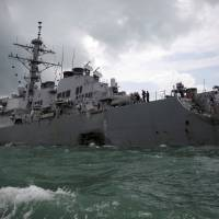 The U.S. Navy guided-missile destroyer USS John S. McCain is seen after an August collision in waters off Singapore. | REUTERS