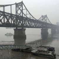 Due to repairs, North Korea says it will temporarily close bridge linking nation to China