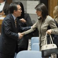 U.S. Ambassador to the United Nations Nikki Haley shakes hands with South Korean Ambassador Cho Tae-yul after a Security Council meeting on the situation in North Korea on Wednesday. | AP