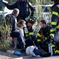 A woman is aided by first responders after being injured during a terrorist attack on a bike path in lower Manhattan in New York on Tuesday.   REUTERS