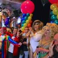 Members of Sydney's gay community celebrate Wednesday at a pub in the city after it was announced the majority of Australians support same-sex marriage in a national survey, paving the way for legislation to make the country the 26th nation to formalize the unions by the end of the year. | REUTERS