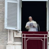 Pope Francis prepares to address the crowd from the window of the apostolic palace overlooking St. Peter's square during the Sunday Angelus prayer at the Vatican. | AFP-JIJI
