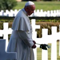 Pope Francis tours WWII sites, calls war 'the destruction of ourselves'