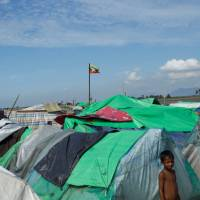 A Rohingya Muslim boy stands as he waits to cross the border to go to Bangladesh, in a temporary camp outside Maungdaw, northern Rakhine state, Myanmar, Sunday. | REUTERS